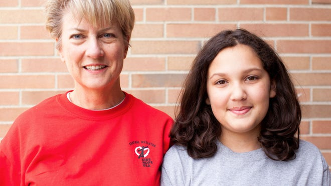 A mentor with Kids Hope USA poses with a student. The Zeeland-based nonprofit, which has expanded to 37 states, is celebrating its 25th year amid the coronavirus.