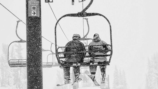 Skiers ride a lift at Mt. Rose Ski Tahoe in December 2008. High winds on Friday, Feb. 6, 2015 interrupted many lift operations.