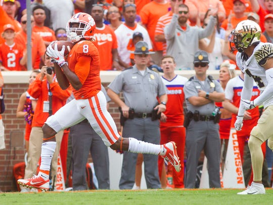 Clemson Tigers wide receiver Deon Cain scores a touchdown during the first quarter against the Wake Forest Demon Deacons at Clemson.