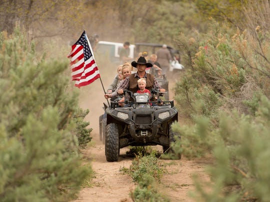 Ryan Bundy, son of rancher Cliven Bundy, rides an ATV into Recapture Canyon north of Blanding, Utah. Phil Lyman was sentenced to 10 days in jail and $96,000 restitution for leading the ride.