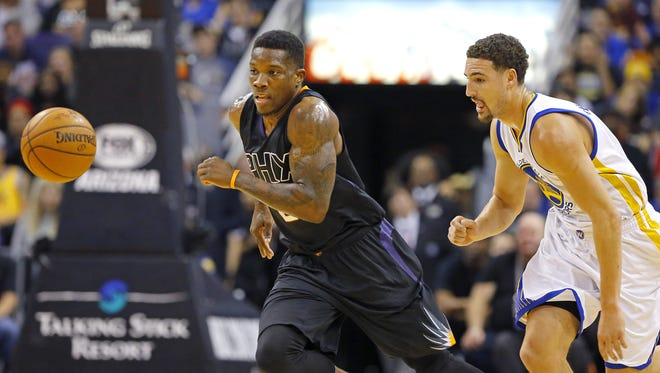 Phoenix Suns guard Eric Bledsoe (2) steals the ball from Golden State Warriors guard Klay Thompson (11)  during the first half of their NBA game Friday, Nov. 27, 2015 in Phoenix, Ariz.