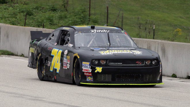 Nic Hammann (74) comes out of the Bill Mitchell bend during the  NASCAR Xfinity Road America 180 Powered By Johnsonville on Saturday.