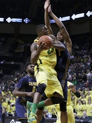 Oregon's Elgin Cook looks for a shot against California's Ivan Rabb, right, during the first half of an NCAA college basketball game Wednesday, Jan. 6, 2016, in Eugene, Ore. (AP Photo/Ryan Kang) AP