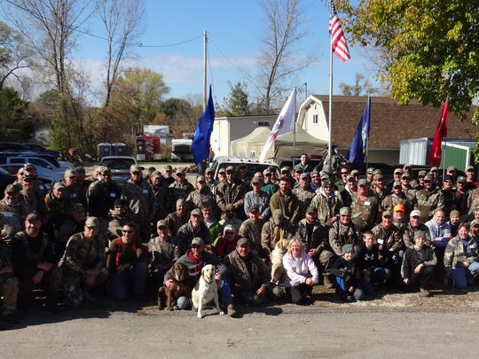 U.S. military service members, veterans and volunteers pose for a photo Oct. 22 during the 2016 activities organized by nonprofit group Horicon Marsh Veterans Hunt Inc. Sixty military veterans and active personnel took part in this year's event.