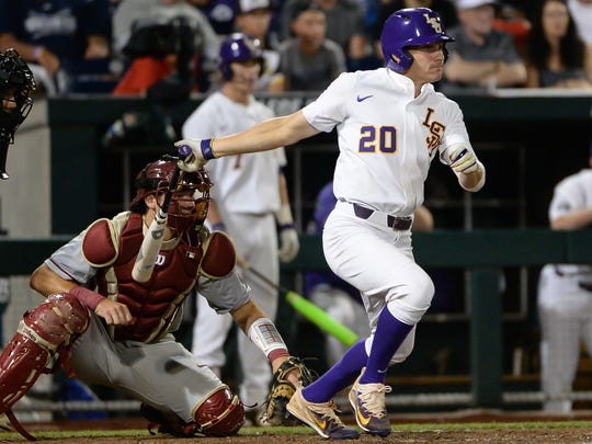 Jun 17, 2017; Omaha, NE, USA; LSU Tigers outfielder Antoine Duplantis (20) drives in the tying run in the eighth inning against the Florida State Seminoles at TD Ameritrade Park Omaha. Mandatory Credit: Steven Branscombe-USA TODAY Sports
