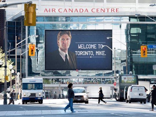 A sign welcoming Mike Babcock as the new head coach of the Maple Leafs  is displayed outside of the Air Canada Centre in Toronto on Thursday.