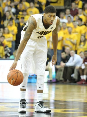 Leading scorer Roy Devyn Marble and the No. 12 Iowa Hawkeyes host No. 6 Michigan State on Tuesday night.