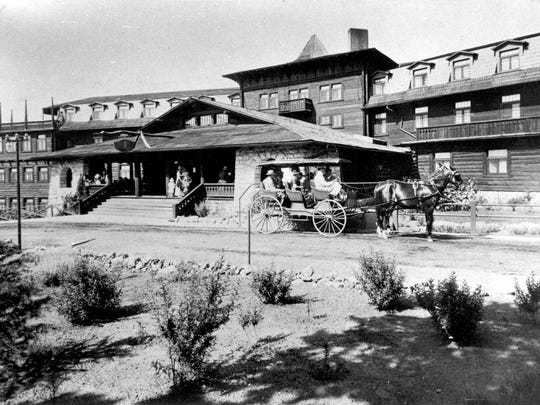 A horse carriage in front of the entrance to the El