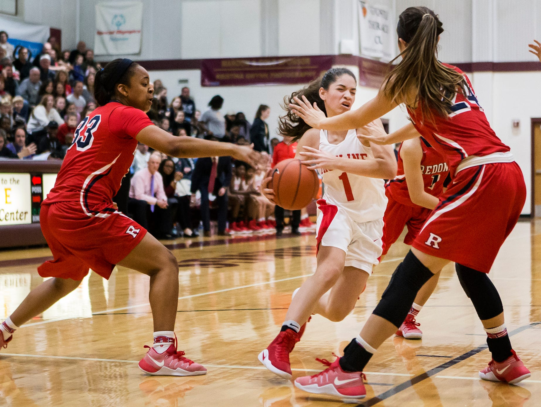 Ursuline's Alisha Lewis (No. 1) drives to the basket through a group of Redondo Union defenders in the first half of Ursuline's 39-26 win over Redondo Union High School in the Diamond State Classic at St. Elizabeth High School in Wilmington on Tuesday night.