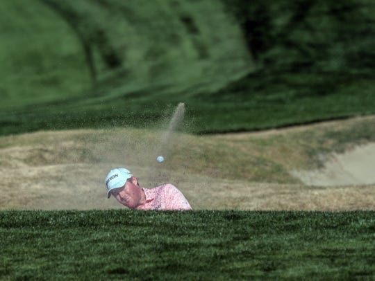 American Grayson Murray hits his ball out of the sand