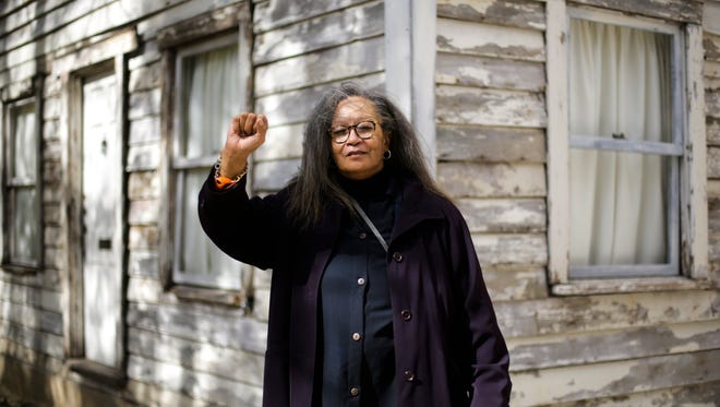 In this April 6, 2017 photo Rhea McCauley a niece of Rosa Parks poses in front of the rebuilt house of Rosa Parks in Berlin. McCauley donated the former Detroit house of Rosa Park to American artist Ryan Mendoza  who has taken apart the  Michigan house that Rosa Parks once lived in and rebuilt it in the German capital, to raise awareness about the late civil rights activist and her legacy.
