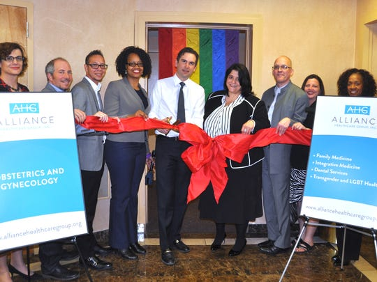 Jersey City Mayor Steven Fulop (center, white shirt) attends the ribbon-cutting ceremony for Alliance Community Health, the first clinic for transgender people in New Jersey.