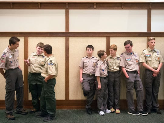 Members of Sevier County Boy Scout Troop 119 wait to tend to guests during the Great Smoky Mountain Council's Sevier County Good Scout Award Dinner on Tuesday, April 25, 2017. The dinner honored the first responders of the Gatlinburg wildfires.