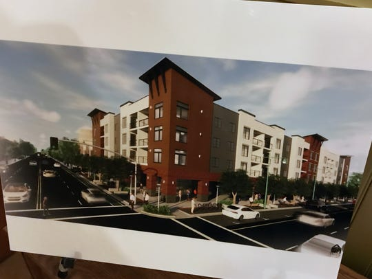 An artist rendering shows plans for a mixed-use project to replace half of the aging parking structure in downtown Redding.