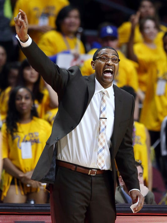 Cal State Bakersfield head coach Xavier Johnson shouts to his team during the first half of an NCAA college basketball game against Seattle in the Western Athletic Conference women's tournament championship Saturday, March 10, 2018, in Las Vegas. Seattle won 57-54. (AP Photo/Isaac Brekken)