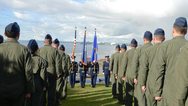 Airmen from the 20th Expeditionary Bomb Squadron currently deployed to Andersen from Barksdale Air Force Base, Louisiana, stand at attention for the Guam Hymn during the Raider 21 memorial ceremony July 21, 2015, in Adelup, Guam. Members of Team Andersen and representatives from the Government of Guam gathered together to remember the six Airmen who lost their lives when a B-52 Stratofortress with call sign Raider 21 crashed off the coast of Guam July 21, 2008.