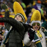 A pair of fans dance in the second half. The Green Bay Packers hosted the Minnesota Vikings at Lambeau Field in Green Bay, Wis. on Sunday, Jan. 3, 2016.