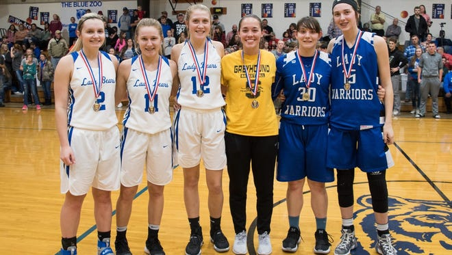 The all-tournament girls' team for the Battle of the Border Tournament in Mammoth Spring is (from left) Whitlee Layne, Terra Godwin and Lauren Mitchell of Mammoth Spring, Kaylea Walling of Salem, Marie Reed and Alexa Wooten of Cotter, and (not pictured) Mariah Smith of Eminence, Mo.