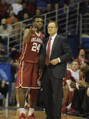 Oklahoma coach Lon Kruger, right, says his star Buddy