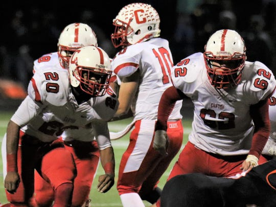 Offensive lineman Jake Warner (No. 62) and running back Julian Thornton (No. 20) stand side-by-side for the Canton Chiefs as they did all season. The seniors shared team MVP honors for 2016. Also shown is senior quarterback Jake O'Donnell (No. 10).