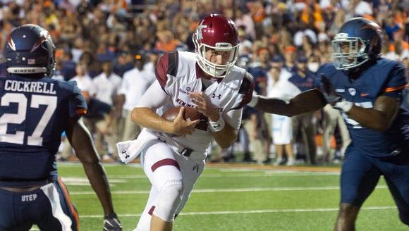 NMSU quarterback Tyler Rogers splits two UTEP defenders