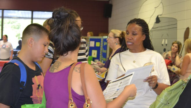Sgt. Shannon Burchfield-Wise (right) speaks about Fort Polk's Comprehensive Soldier & Family Fitness program at the second annual Cafeteria Conversation, a large-scale informational fair at at North Polk Elementary School located on the post, on Tuesday.