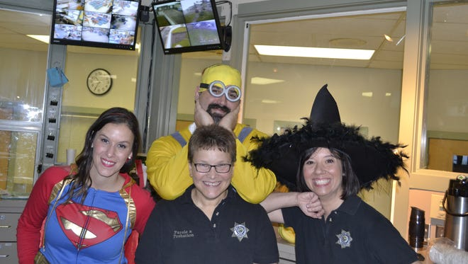 Attendees of the Marion County Work Center's 2015 Halloween party pose for a photo.