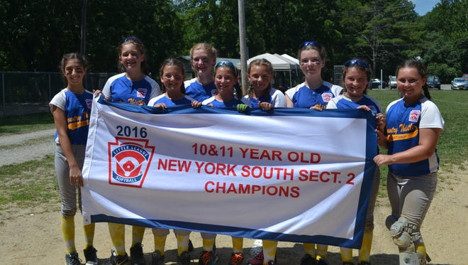 Pleasant Valley's 10-11 softball team poses after winning the Section 2 championship Saturday.