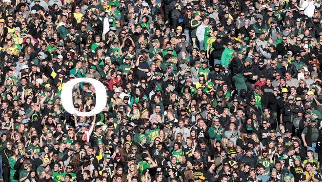 Nov 21, 2015; Eugene, OR, USA; Oregon Ducks fans hold a large sign in the crowd against the USC Trojans at Autzen Stadium. Mandatory Credit: Scott Olmos-USA TODAY Sports