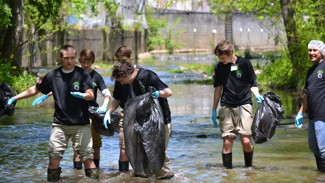 Volunteers from Rich Products Corporation cleaned a section of Town Creek during a past cleanup event.