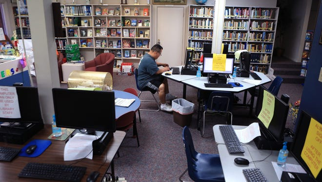 Daniel Arellano uses computers at the Taft Public Library on Thursday, March 23, 2017. The library is celebrating its 90th anniversary on Saturday, April 1.