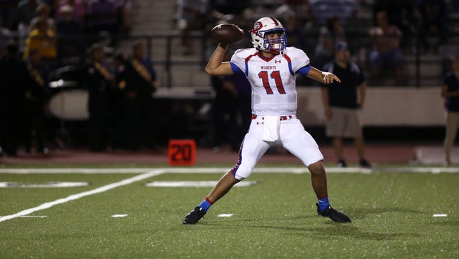 Gregory-Portland Wildcat quarterback Austin Ochoa (looks for an open receiver in the second quarter of the game against the Miller Buccaneers at Buccaneer Stadium on Friday, October 6, 2017.