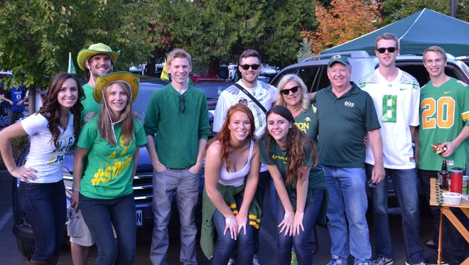 Ducks fans, some of who have been tailgating for more than 31 years, gather together at one of the main tailgate parties outside Autzen Stadium on Saturday.