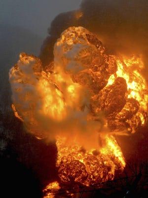 A fire burns Monday after a train derailment near Charleston, W.Va.