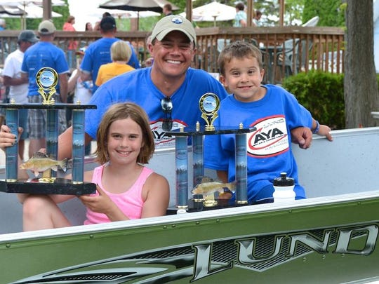 Chris Jeanquart, his 9-year-old daughter, Sydney, and 5-year-old son, Grant, won the first annual Young Angler walleye tournament in Door County earlier this month. The trio won some large trophies, a Lund Boat and Mercury Outboard and a free entry to the AYA championship in Canada later this summer.