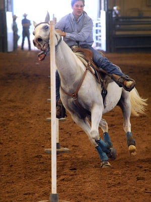 Sydney Harris of Bosque County guides her horse Dakota around the last pole during pole bending during the 2016 Texas State 4-H Horse Show.