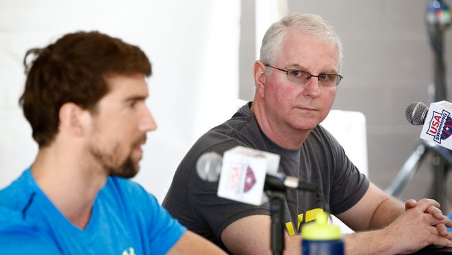 18-time Olympic gold medalist Michael Phelps and coach Bob Bowman (right) hold a press conference at the Arena Pro Swim Series on Wednesday, April 15, 2015 at Skyline Aquatic Center in Mesa, AZ. Phelps, 29, returns from a six-month suspension by USA Swimming after his arrest Sept. 30 when he was accused of driving under the influence. Phelps pleaded guilty to that charge in December was sentenced to 18 months supervised probation in lieu of one year in prison. The probation includes random drug and alcohol testing. Phelps also completed a 45-day treatment program in Arizona.