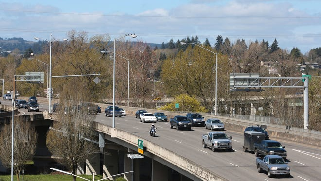 Traffic moves over the Center Street Bridge in downtown Salem.