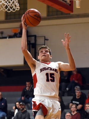 Rosecrans' Derek Kunkler goes up for a shot last season against Coshocton. Kunkler is the only Bishop returning with any varsity experience, as coach Todd Rock aims to regroup from losing a heralded senior class.