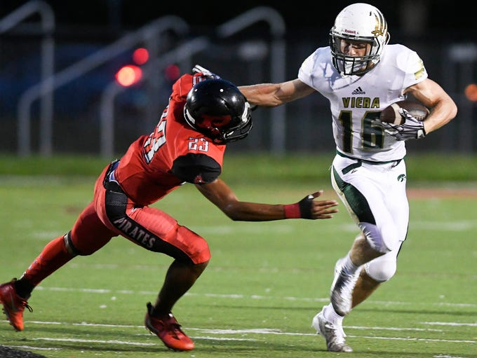 Sean Atkins of VIera gets around the tackle of Palm