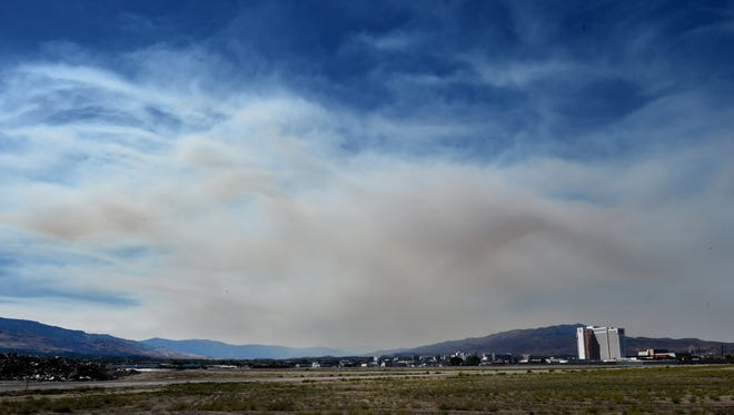 Smoke from the King Fire near Placerville pours into the Truckee Meadows on Tuesday afternoon in this view from Mill Street near Reno-Tahoe International Airport.