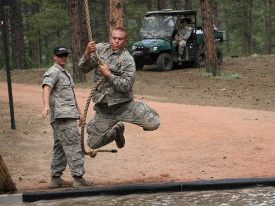 Gulf Coast High School graduate Johnny Griffith completes an obstacle course at the U.S. Air Force Academy.