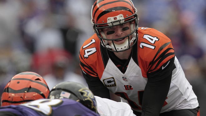 Cincinnati Bengals quarterback Andy Dalton (14) makes a call from the line of scrimmage during the fourth quarter of the NFL Week Three game between the Baltimore Ravens and the Cincinnati Bengals at M&T Bank Stadium in Baltimore on Sunday, Sept. 27, 2015. The Bengals advanced to 3-0 with a 28-24 win over the Ravens.