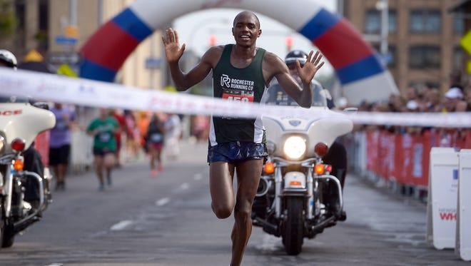 Kip Tisia of Rochester finishes the MVP Health Care Rochester Marathon in first place for men Sept. 18, 2016.