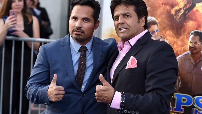 """Michael Pena, left, and Erik Estrada pose at the Los Angeles premiere of """"CHIPS"""" at the TCL Chinese Theatre on Monday, March 20, 2017. (Photo by Jordan Strauss/Invision/AP)"""