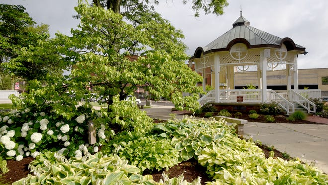 Several areas, including Central Park in Mansfield, were prepped for America in Bloom judges' visit July 10-11. Mansfield earned a top award for landscaped areas as well as an honorable mention for heritage preservation.