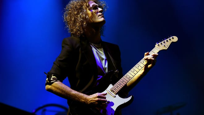 Musician Dave Keuning of The Killers performs onstage during the grand opening of T-Mobile Arena in Las Vegas.