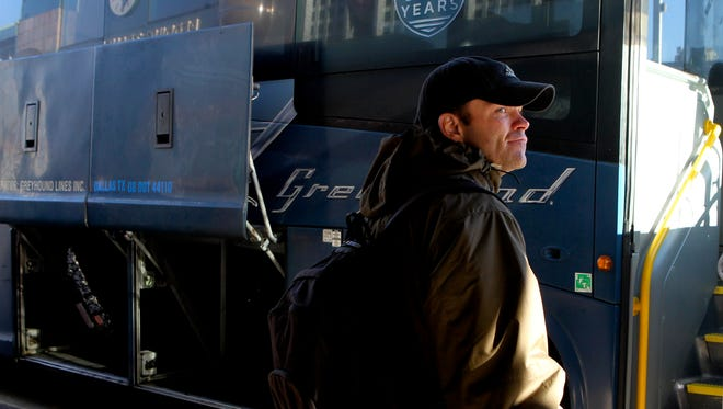 FILE PHOTO - Allen Johnson prepares to board a Greyhound bus Christmas morning, 2014, for a trip to Colorado Springs, Colo. Johnson is one of more than 300 people served by the Good News Rescue Mission's Journey Home program.
