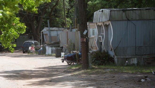Impoverished residents of a West Pensacola mobile home park were left with no choice but to live in health-threatening conditions because they lacked the means to go anywhere else. The Bill & Melinda Gates Foundation funded a national study on ways communities can make it easier for people to climb out of poverty.