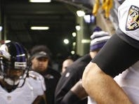 Baltimore Ravens quarterback Joe Flacco (5) celebrates with Ravens outside linebacker Terrell Suggs (55) after their game against the Pittsburgh Steelers in the 2014 AFC Wild Card playoff football game at Heinz Field. The Ravens won 30-17.